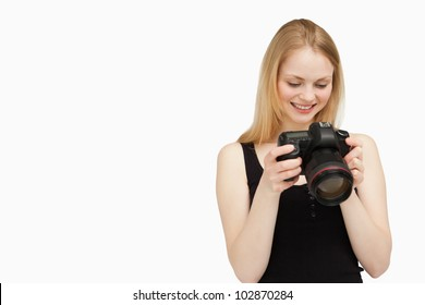 Cheerful woman looking at her camera against white background