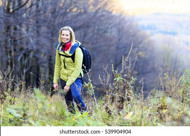 Cheerful woman in nature hike.