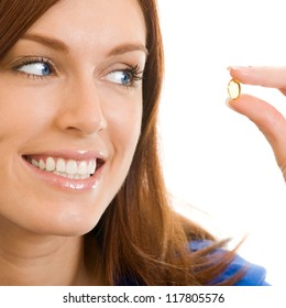 Cheerful woman with Omega 3 fish oil capsule, isolated over white background