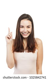 Cheerful woman pointing at copy space, isolated on white
