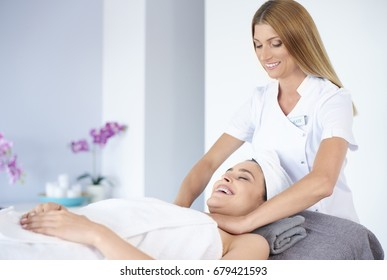 Cheerful woman receiving a massage