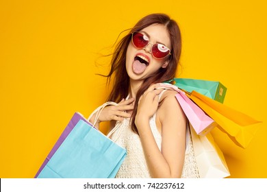 cheerful woman, shopping trip, color packs