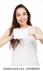 Cheerful woman showing a blank signboard, isolated on white