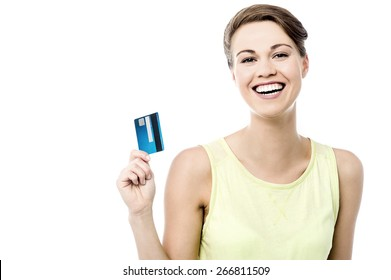 Cheerful woman showing her new credit card