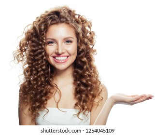 Cheerful woman showing open hand with empty copy space isolated on white. Expressive facial expressions.