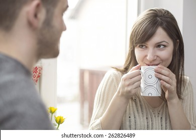 Cheerful woman talking with man
