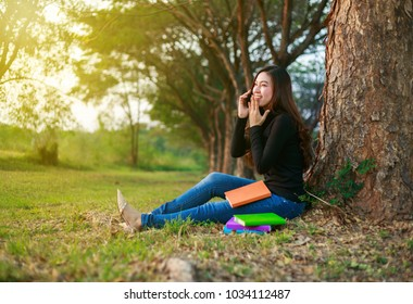 cheerful woman talking on mobile phone in the park