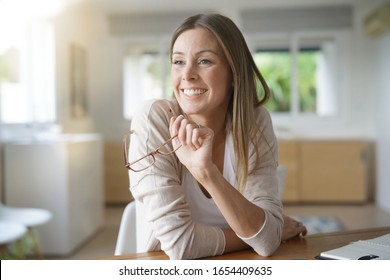 Cheerful woman working from home