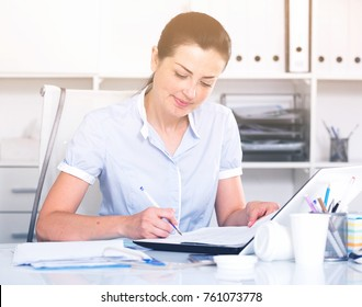 cheerful woman working in the office at the modern laptop