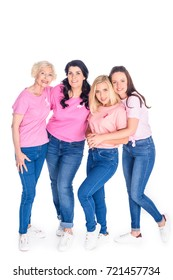 cheerful women in pink t-shirts with ribbons smiling at camera isolated on white