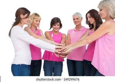 Cheerful women posing in circle wearing pink for breast cancer on white background