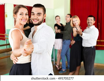 Cheerful young   adults having grave dances  in class