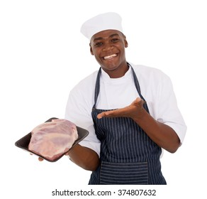 cheerful young african butcher presenting fresh meat