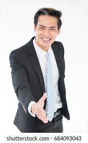 Cheerful young Asian man greeting business partner