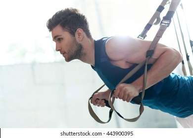 Cheerful young athlete doing exercise