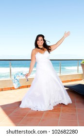 cheerful young bride on balcony