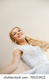 Cheerful young bride on the happiest day of her life