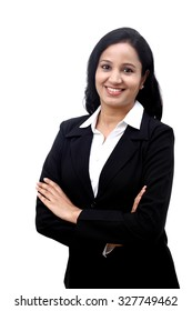 Cheerful young business woman with folded hands against white background.