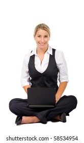 cheerful young business woman sitting on floor and working on a laptop, isolated on white