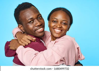 Cheerful young couple of African appearance hugs communication lifestyle studio