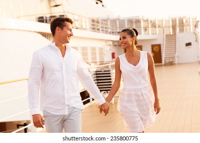 cheerful young couple walking on cruise ship