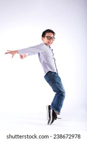 Cheerful young dancer performing freeze move on his toes