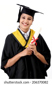 Cheerful young female student holding diploma against white