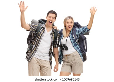 Cheerful young hikers waving at the camera isolated on white background