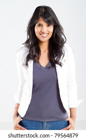 cheerful young indian woman portrait over white