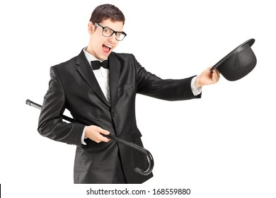 Cheerful young man in a bow tie suit and top hat isolated on white background