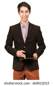 Cheerful young man businessman in suit working on digital tablet and smiling while standing isolated on white background