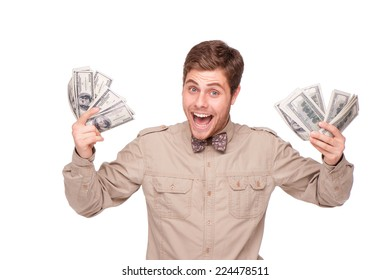 Cheerful young man holding soft money and happily smiling, isolated on white