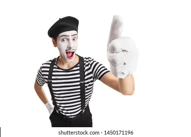 Cheerful young pantomime man showing thumbs up isolated on white background