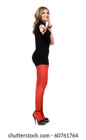 Cheerful young woman in a black dress and red tights