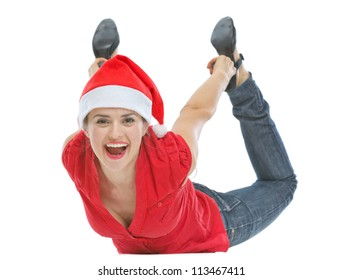 Cheerful young woman with Christmas hat laying on floor