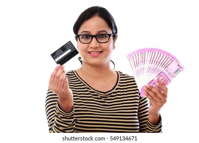 Cheerful young woman with credit card and Indian rupee notes-Concept of cashless economy