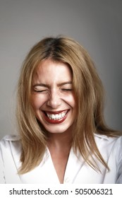 Cheerful Young Woman Laughing. Funny Blond Woman Laughter