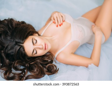 cheerful young woman in  light body posing in a huge bright darge spacious room , beautifull shoot, trendy toning , creative computer color