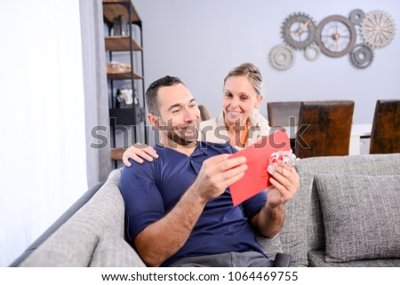 Cheerful Young Woman Offering Surprise Present Stock Photo Edit Now