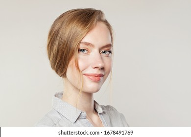 Cheerful young woman smiling on white banner background