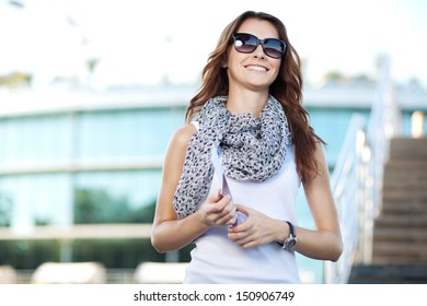 cheerful young woman tourist holding passport and pass ticket