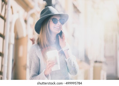 Cheerful young womna talking on cell phone