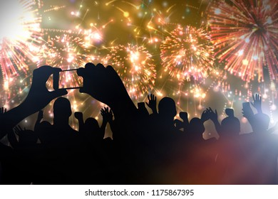 Cheering crowd and fireworks. Celebrating new year's party