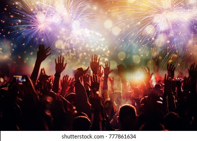 cheering crowd watching fireworks - new year concept
