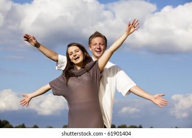 cheering teenage couple