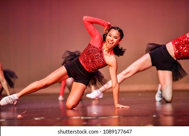 Cheerleader and dancer performing on stage during a show