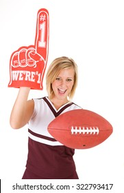 Cheerleader: Young Woman Holds Up Foam Finger And Football