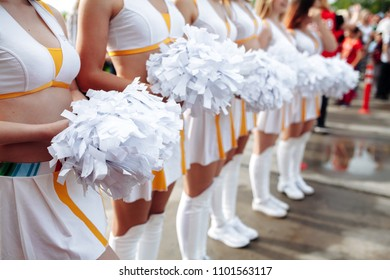 Cheerleaders in white Uniform Holding Pom-Poms. Close up . football championship