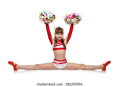 cheerleading girl with pompoms sits on a splits
