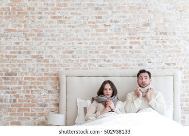 Cheerless depressed couple suffering from influenza together